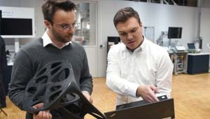 two technicians discussion about a 3D printed chair for the industrial video