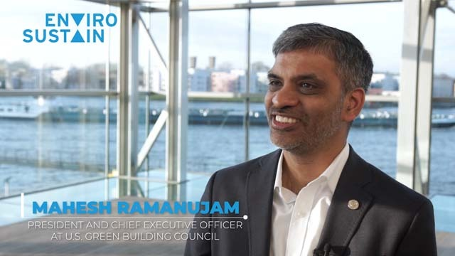 Smiling CEO answering video interview question