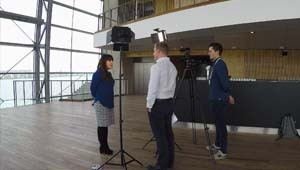 Interview setup, one woman answering two man