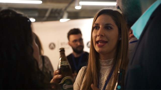 One woman networking with two persons for the Berlin Aftermovie